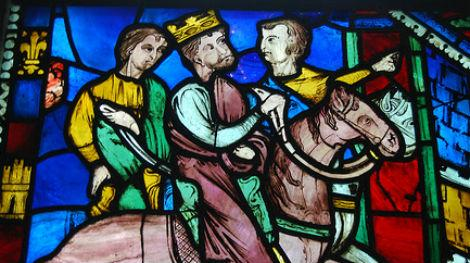 Stained Glass window of a king riding on a horse